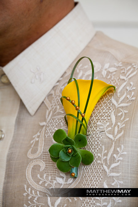Calla lily boutonniere worn by the groom