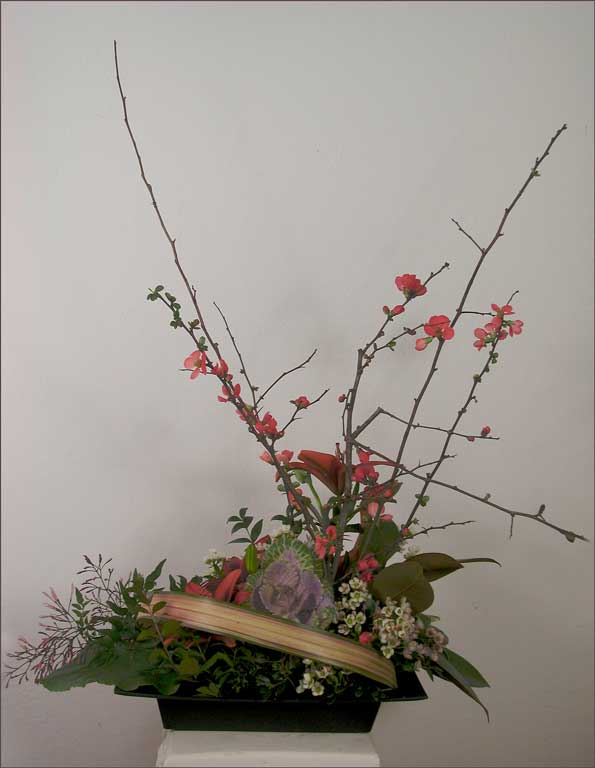 seasonal branches ikebana with lilies, harakeke, decorative cabbage