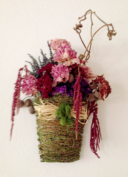 Dried flowers arranged in curly willow basket by Yukiko
