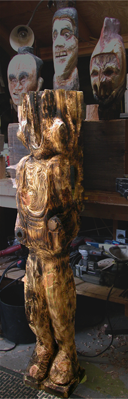 """Survivor"" & heads/faces, WIP 2014;  wood sculpture, fir, 2014, by Peter Neibert"