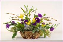 Natural, clear and calm: lilies and lisianthus in basket. Keaton Mortuary
