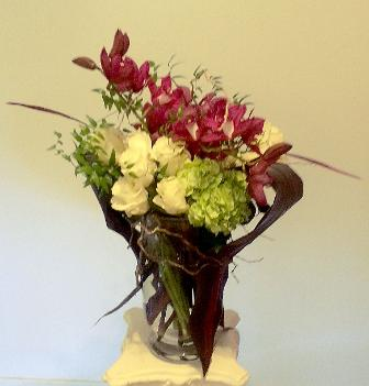 white roses arrangement with orchids