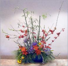 Chinese New Year's theme in bamboo and flowering quince ikebana.