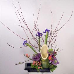 bamboo ikebana with seasonal flowers purple