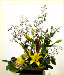 blackberry branch ikebana with yellow flowers