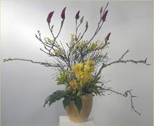 magnolia branches with cymbidium ikebana yellow