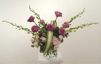 sophisticated rose bouquet with mixed roses, orchids, harakeke