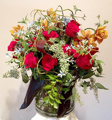 Roses and orchids bouquet in glass vase