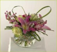 roses, lilies, spherical glass vase