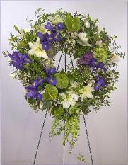 funeral wreath: Dutch iris, anthurium, lilies, kale - Greenbrae CA