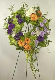 funeral wreath, purple and lavendar lisianthus with safron roses, green orchids and chrysanthemums, Mill Valley